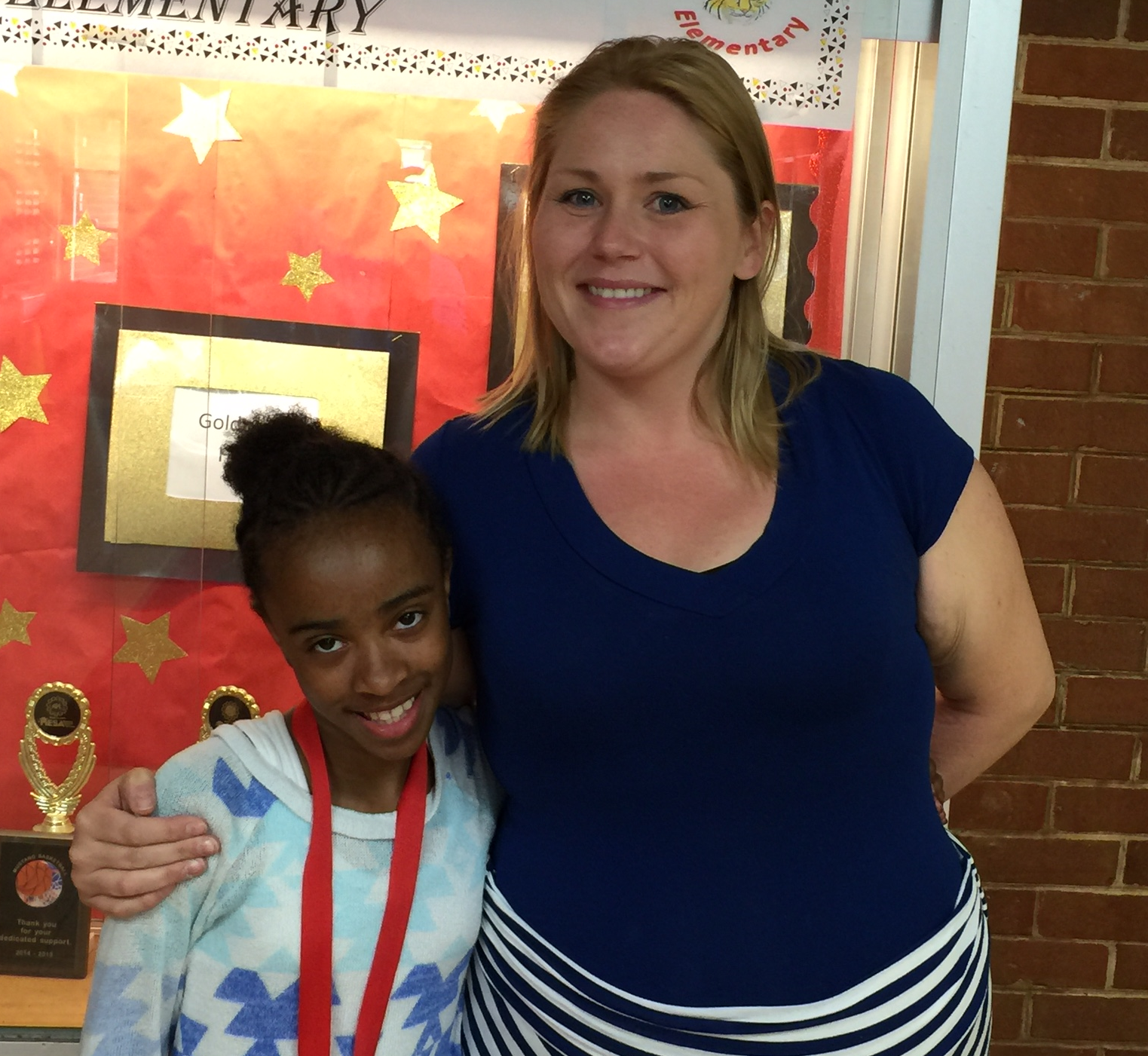 Mrs. Lohrmann standing with one of her fifth grade students.