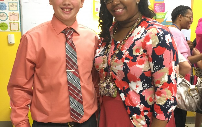 Logan standing with Ms. Tanya