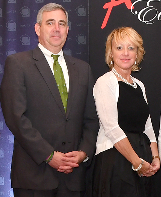 Dr. Arlotto standing with Lori Berry